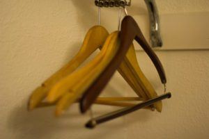 Coat hangers in a sad cheap hotel