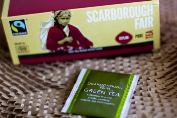 A box of tea bags and a single tea bag from Fairtrade provider Scarborough Fair